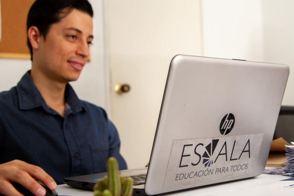 Escala employee working on his computer