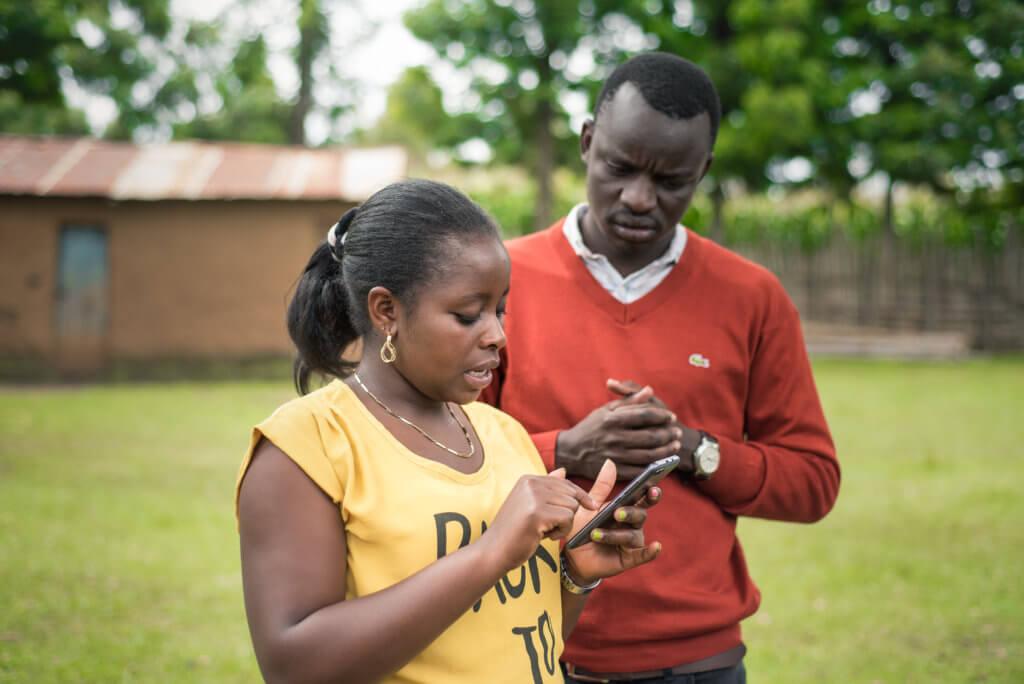 Apollo agents using mobile phone in Nakuru, Kenya