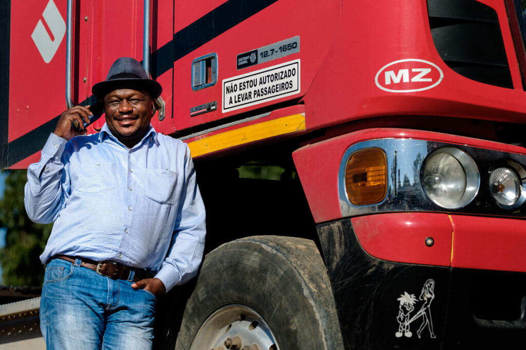 Jose standing beside his red truck